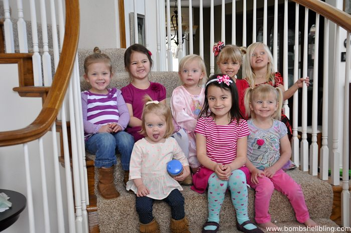 Eight preschoolers sitting on stairs at disney junior birthday party
