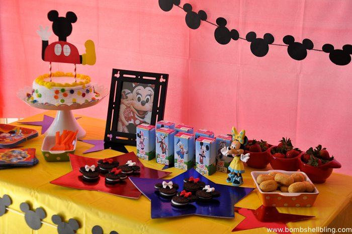 Table with various treats for disney junior birthday party