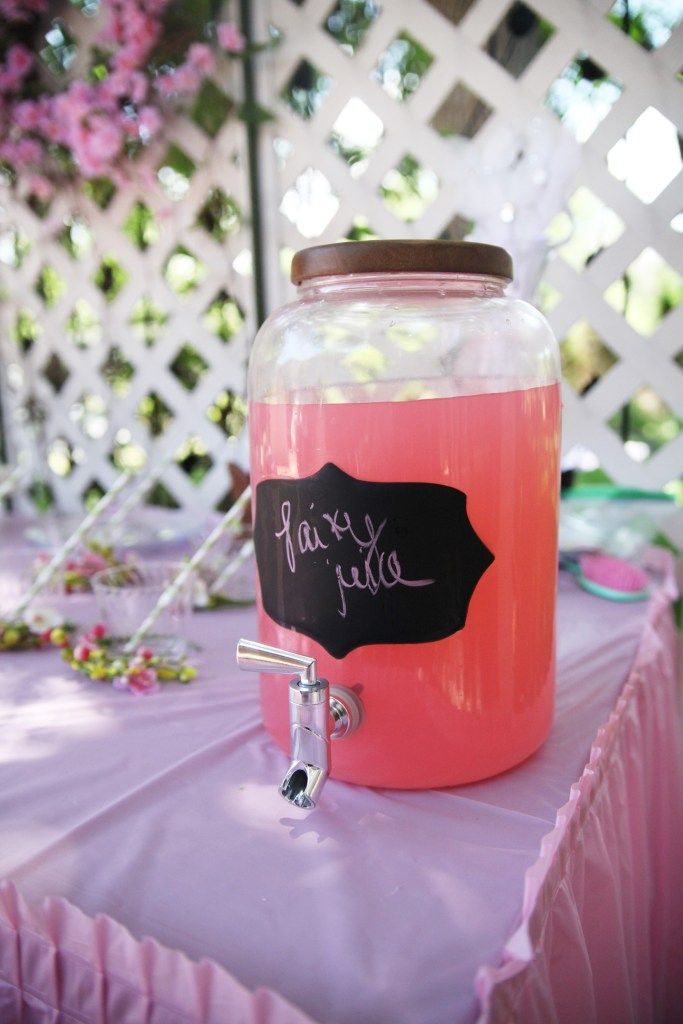 Pink punch in glass jar on table at fairy birthday party