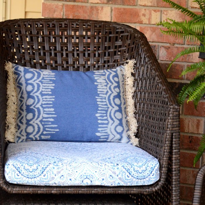Bring an easy-going summer vibe to your front porch with this Boho bleach denim pillow!  The bleached designs and fluffy cotton fringe remind me of music festivals and laid back days at the beach.