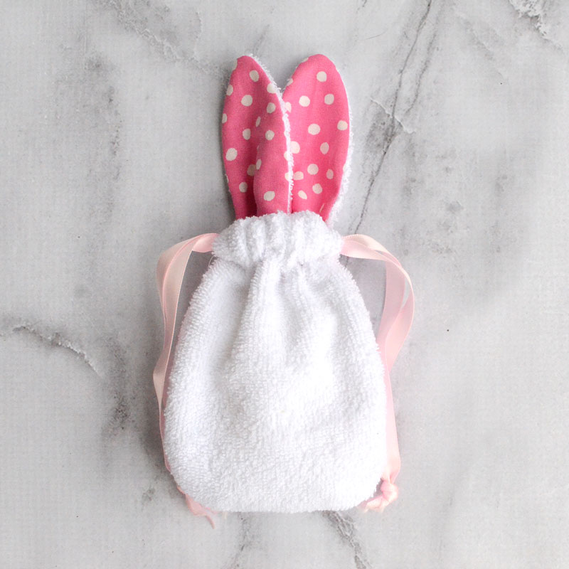 Sew a bunny soap pouch that's perfect for Easter baskets –and can be used all year!  The little soap holder with bunny ears makes bathtime fun while also cutting down on the mess around the tub.  Just slip a bar of soap into the drawstring pouch and you've got a fun bathtime accessory!