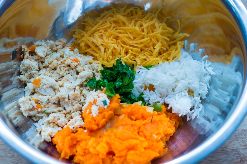 Carrots, chicken, cheddar, rice in a metallic bowl