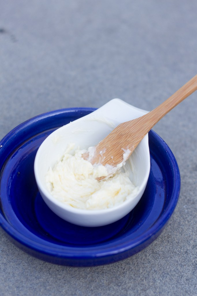 Compound butter in a small white dish placed in a bigger blue dish