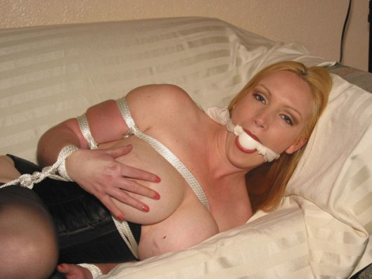 Busty Blond Housewife tightly bound and gagged at Home