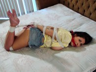Busty Girlfriend is tightly hogtied and gagged with red Bandana