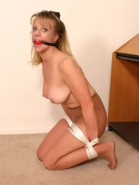 Horny Wife bound and gagged wearing only Pantyhose