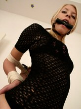 Hot Blond Girlfriend tied and gagged in sexy Boots