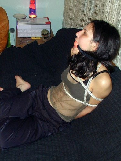 Hot young Brunette Ball gagged and tied tight at Home