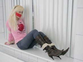 Hot young Girlfriend is tied up and gagged in sexy Boots