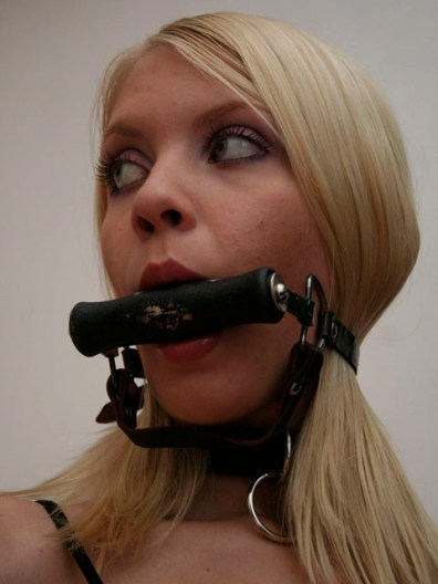 Sexy young Blond restrained and gagged on the Floor