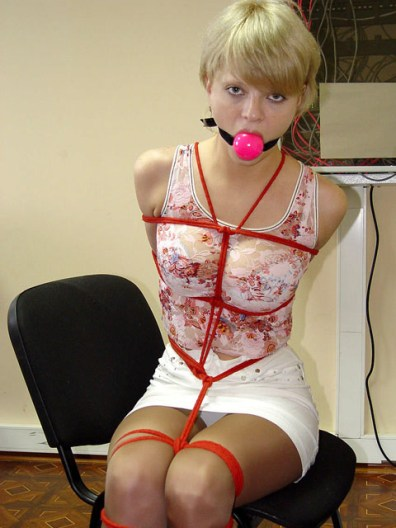 Submissive Secretary tightly tied and Ball gagged
