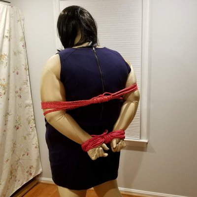 Jennifer is tied up, with her arms behind her back