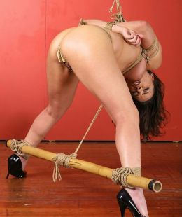 Beautiful Brunette in Heels Gets Tightly Bound, Stripped and Spread