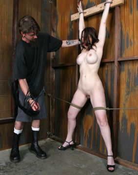 Busty Young Slave Gets Gagged and Restrained in the Dungeon for Fun