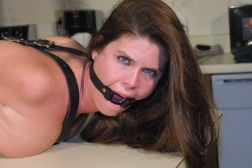 Gorgeous Housewife Gets Strapped and Gagged by Her Husband at Home