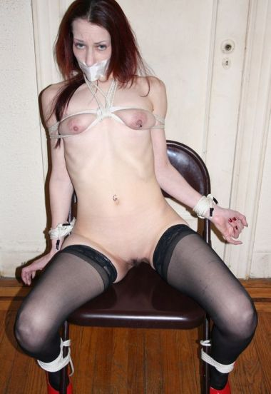 Gorgeous Redhead in Stockings Gets Tape Gagged, Bound and Disciplined