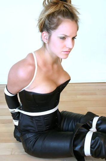 Hot Young Blonde in Corset and High Heel Boots Gets Bound and Gagged