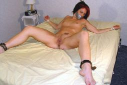 Kinky Young Amateur Restrained and Tape Gagged on the Bed for Fun