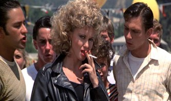 Olivia Newton-John as Sandy in Grease after transformation smoking cigarette