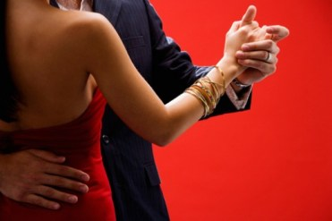Couple dancing arm in arm