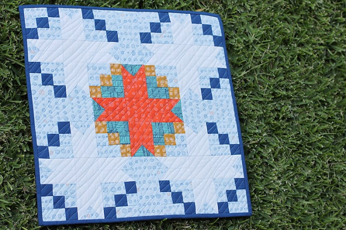 A mini quilt 'True North' made in Carolyn Friedlander's Doe fabric line. At Bonjour Quilts.