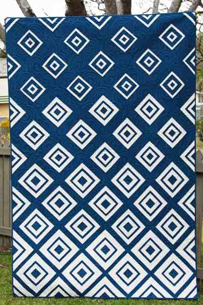 Diamonds in the Deep pattern by Bonjour Quilts - a navy and white version. Pattern available.