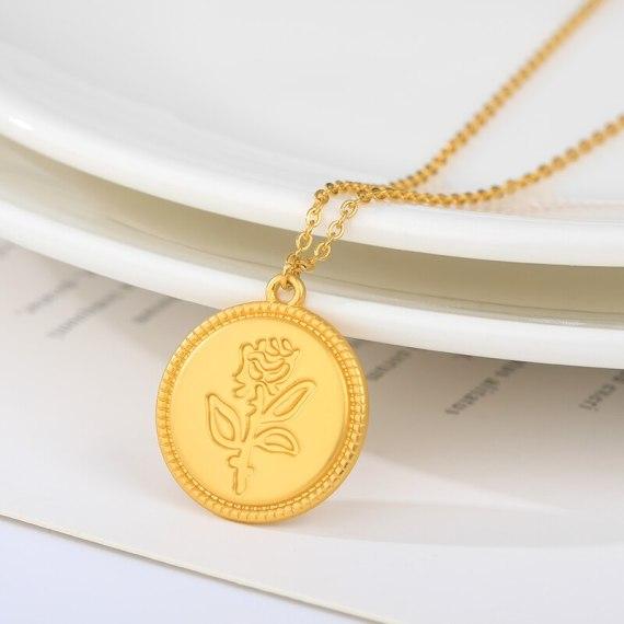 embossed rose flower circle emblem necklace