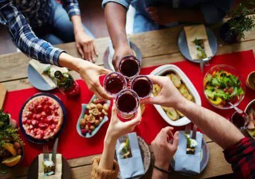 friends eat dinner together