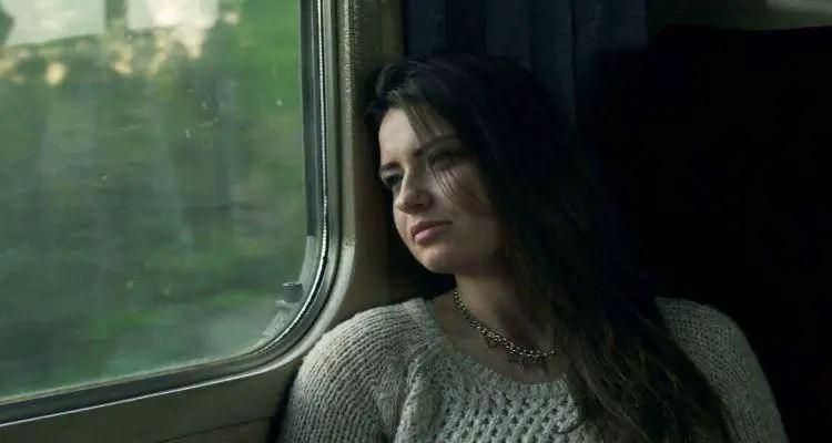 An upset woman, thinking