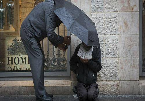 man-helping-the-homeless