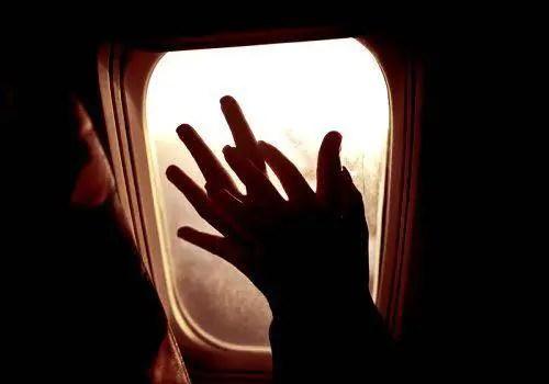 couple hands in flight