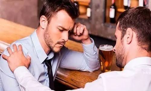 sad man talking to another man