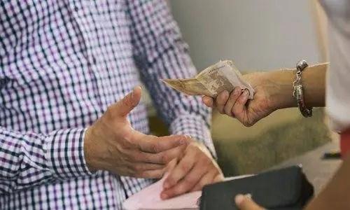 woman giving man money