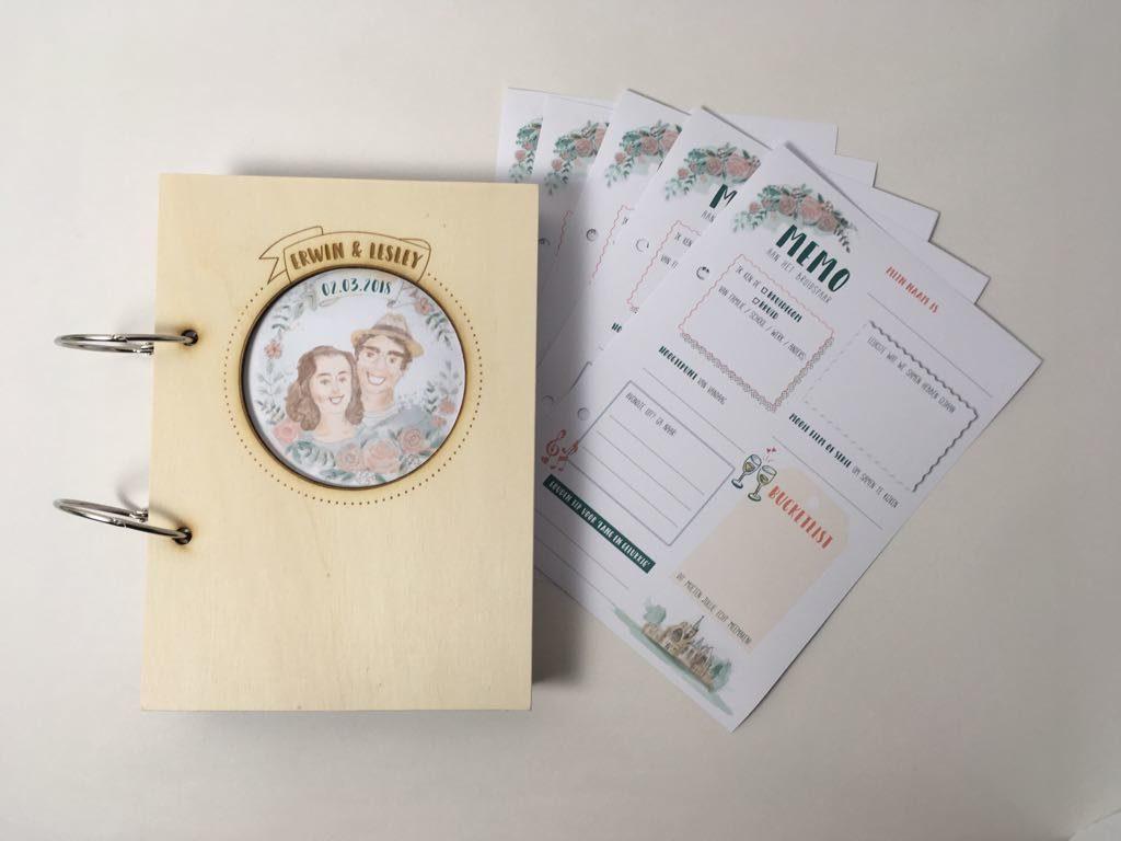 gastenboek met illustratie van het bruidspaar en invulkaarten