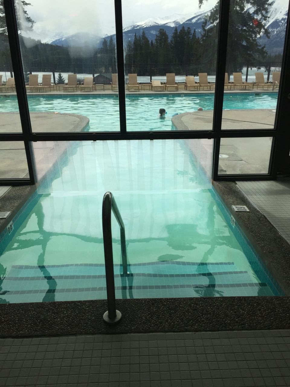 <em><strong>Rocky Mountaineer</strong></em> ~ Indoor/Outdoor Pool at the Fairmont Jasper Park Lodge