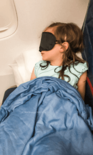 child sleeping on plane