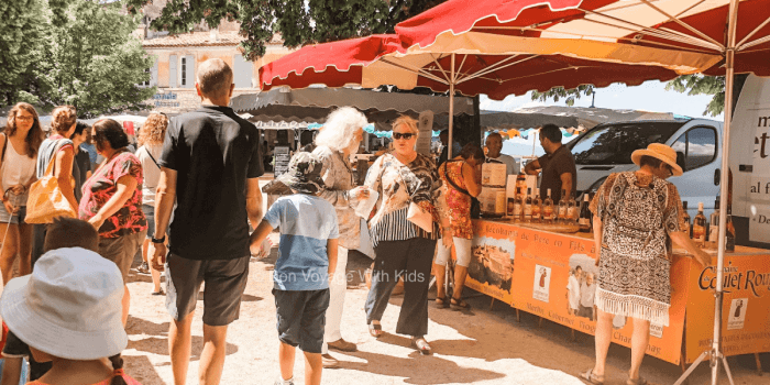 People walking through a French market