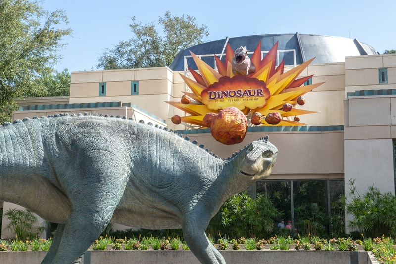 best disney world rides for preschoolers and school age dinosaur in front of dinosaur ride in Animal Kingdom