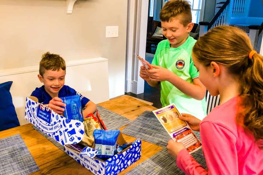 universal yums review kids looking at box contents