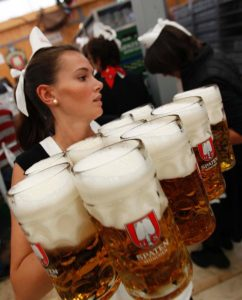 A waitress serves beers during the opening ceremony of the Oktoberfest in Munich