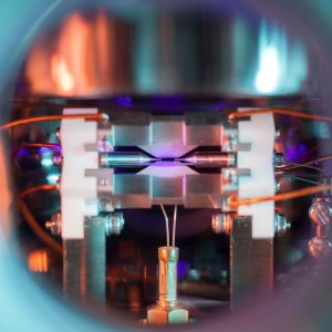 "A remarkable photo of a single atom trapped by electric fields has just been awarded the top prize in a well-known science photography competition. The photo is titled ""Single Atom in an Ion Trap"" and was shot by David Nadlinger of the University of Oxford"
