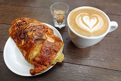 Chocolate almond croissant and coffee