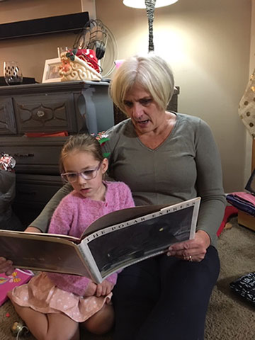 Emmersyn and Grammy share a read-aloud tradition.