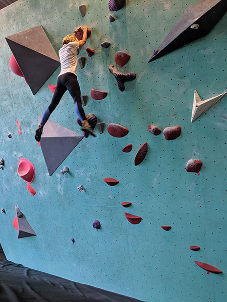 Aimee Bissonette climbing one of the walls at the Minneapolis Bouldering Project.