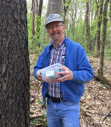 My friend Gary with a geocache