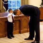 Little Boy Checks out Obama's Haircut