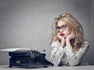 girl staring at Typewriter