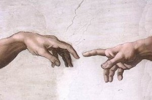 Michaelangelo hands of God and Adam