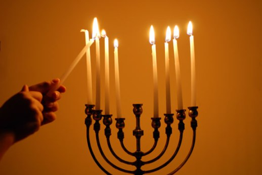 Lighting the Hanukkah menorah