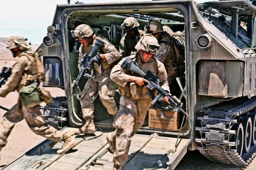 Marines dismounting from an amphibious assault vehicle